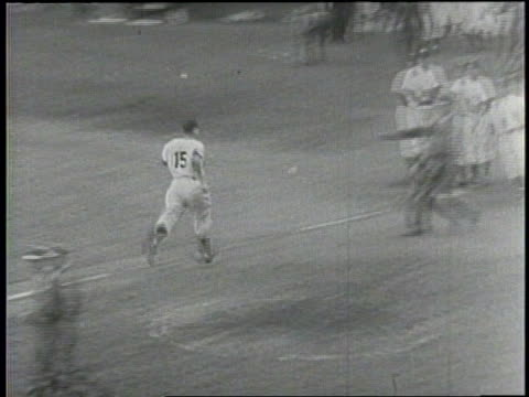 Narrated / Baseball game between The New York Yankees and the Brooklyn Dodgers in the first game of the subway series / Tommy Henrich scores the...