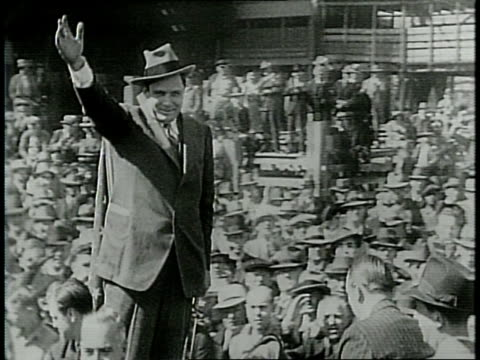 vídeos de stock, filmes e b-roll de narrated / chicago, 1940 / willkie begin his campaign in front of huge crowd at chicago stockyards / promises no involvement in the war / onlookers... - narrating
