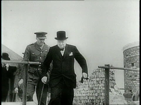 narrated / churchill visits damaged areas / bombers flying in sky / shots of wreckage in london big ben in background / - winston churchill stock videos & royalty-free footage