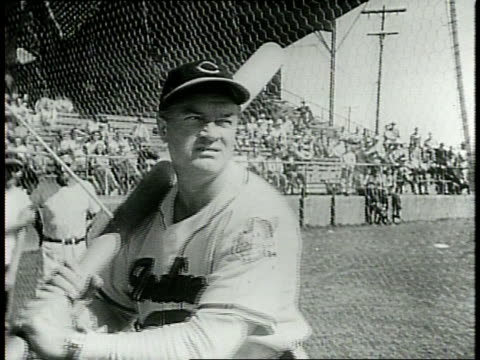 narrated / cleveland indians practice on field / shot of audience / team poses / closeup of lou boudreau / - narrating stock videos & royalty-free footage