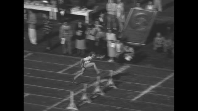 narrated / female competitors line up for the women's 80 meter hurdle event / the athletes take off at the sound of the gun / olympic gold medal... - gold medal stock videos & royalty-free footage