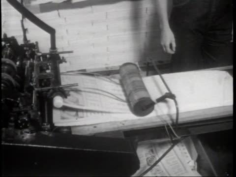 vídeos y material grabado en eventos de stock de narrated / female laborers assemble pinup calendars with glue and matting techniques / company president charlie ward shows off his favorite... - narrar