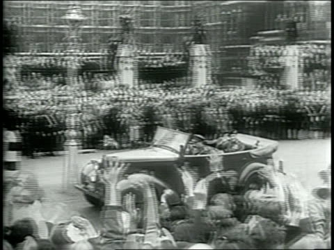 narrated / field marshal montgomery enters parade in a nice convertible car / crowds line the streets cheering / king george vi next to a smiling... - field marshal stock videos and b-roll footage