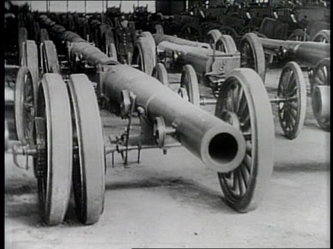 narrated / men lower a piece of artillery / artillery pieces lay together lined up / an artillery hatch is opened / men work on artillery carriages /... - narrating stock videos & royalty-free footage
