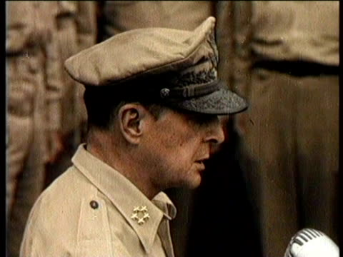 narrated / overhead shot of military leaders gathered on deck of ship / wide shot of ship / overhead shot of macarthur signing document / profile of... - general macarthur stock videos & royalty-free footage