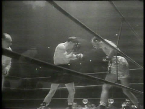 narrated / paris / steve belloise punches jean stock several times in the body and face / marcel cedan watches from the crowd / belloise knocks stock... - narrating stock videos & royalty-free footage