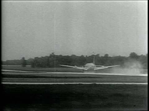 narrated / plane takes off runway / pilot sits and watches steering wheel move by itself / plane levers levitate on their own / series of shots of... - narrating bildbanksvideor och videomaterial från bakom kulisserna