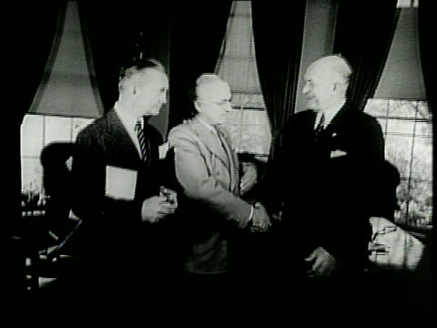 narrated / president truman shakes hands with incoming secretary of defense louis johnson then crosses the other hand across his body and shakes... - narrating stock videos & royalty-free footage