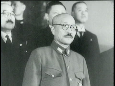 narrated / prime minister hideki tojo and other japanese officials in front of press / offers terms for peace such as america exiting china and end... - prime minister stock-videos und b-roll-filmmaterial