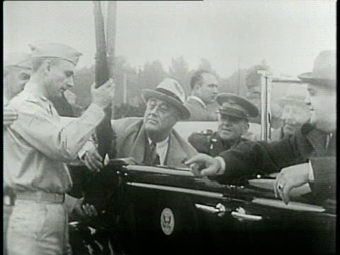 stockvideo's en b-roll-footage met narrated / roosevelt inspects defense industry plants / fdr at army barracks at fort meade / fdr at martin aircraft plant in baltimore / fdr sees new... - maryland staat
