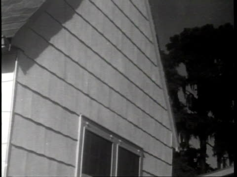 manmade stone / asbestone corporation in new orleans louisiana produces a s stonelike material from cement and asbestos / woman in front yard of home... - asbest stock-videos und b-roll-filmmaterial