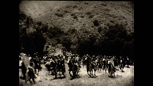 narration describes film's ability to take people to another historic age within a movie theatre; extreme wide views of large grandiose sets filled... - red sea stock-videos und b-roll-filmmaterial