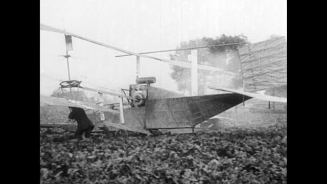[vo narration in french throughout] pilot who might be glenn h curtiss stands near aircraft / vs an early aircraft moves on field takes off /... - glenn h. curtiss stock videos and b-roll footage
