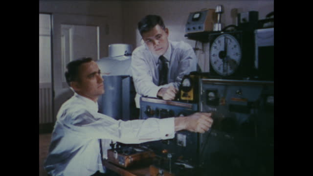 1958 narrator discusses the invention of telephone as technicians at bell laboratories perform tests - rotary phone stock videos and b-roll footage
