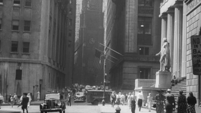 vídeos de stock, filmes e b-roll de 1949 montage narrator discussing falling import prices, trading floor of cbot, flock of sheep being herded, and rubber and cocoa laborers / chicago, illinois, united states - borracha material