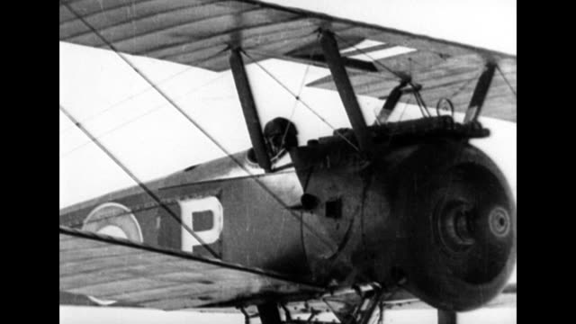 narrator explains how airplanes were used for observation during wwi / plane flying in the sky / countryside smoking from gun fire / machine mounted... - northern european stock videos & royalty-free footage