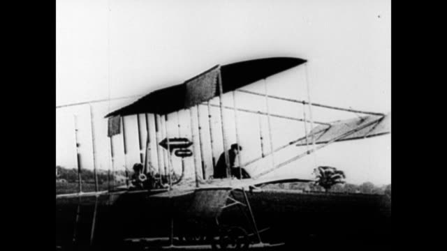 narrator explains that in europe louis bleriot henri farman iii aviators [pullam] and [de happaland] are working on their own airplanes / igor... - 1910 stock-videos und b-roll-filmmaterial