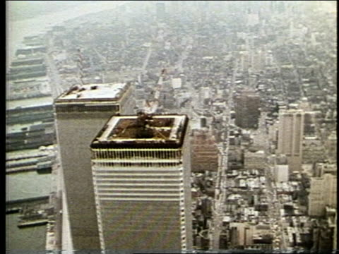2 CLIPS.; 1. VS AERIAL WTC. VO narrator: It is possible to build multi-story environments that have the qualities of a village even in the midst of downtown high-density development.;