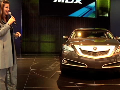 ws narrator talking about interior features as acura zdx revolves on turntable beside herfootage is 43 anamorphic it will play back at 853x480 2010... - curious cumulus productions stock videos and b-roll footage
