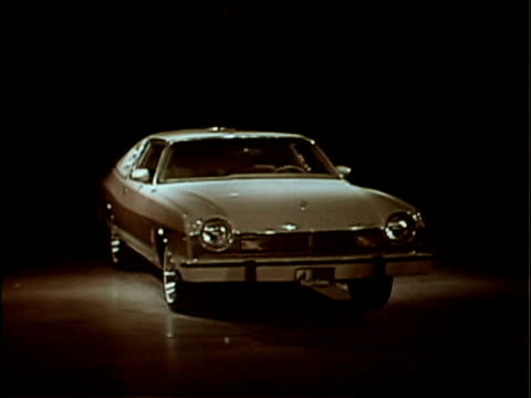 a narrator talks about amc's matador barcelona ii while it revolves on a turntable twotone paint vinyl landau roof a 304 v8 engine and overthetop... - bizarre fashion stock videos and b-roll footage