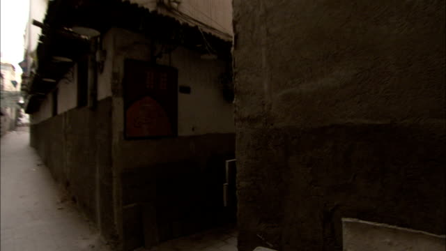 a narrow alley separates buildings in old town damascus. available in hd. - capital cities stock videos & royalty-free footage
