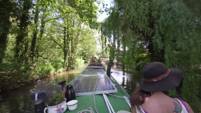 a narrow boat cruising along the river stort - riverbank stock videos & royalty-free footage