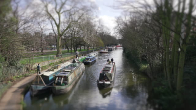 a narrow boat passing along the regent's canal - barge stock videos & royalty-free footage
