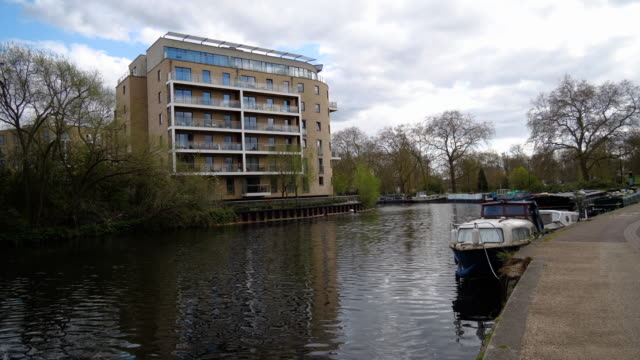 narrow boats and apartment on lea river - barge stock videos & royalty-free footage