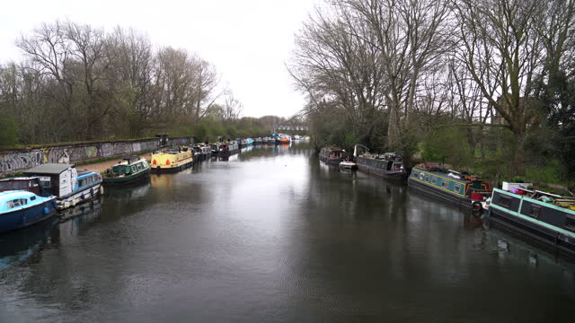 narrow boats on the riverside in london - anchored stock videos & royalty-free footage