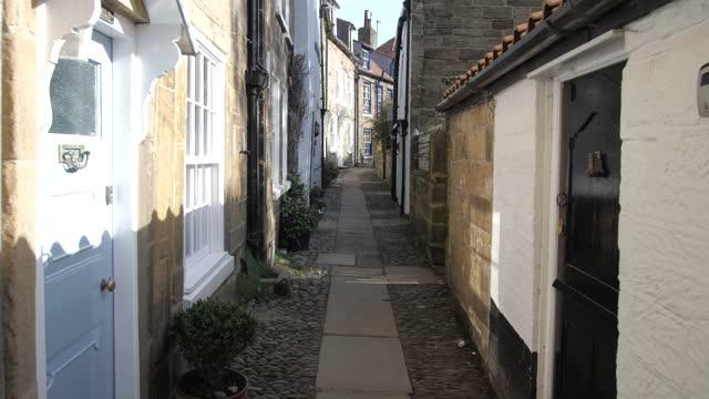narrow cobbled street, robin hood's bay, north yorkshire, england, united kingdom, europe - narrow stock videos & royalty-free footage