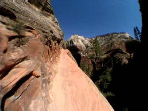 narrow footpath above a deep canyon - rock strata stock videos & royalty-free footage