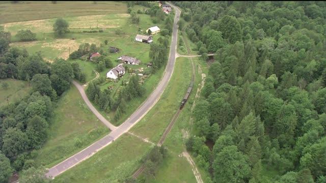 narrow gauge rail in bieszczady mountains - locomotive video stock e b–roll
