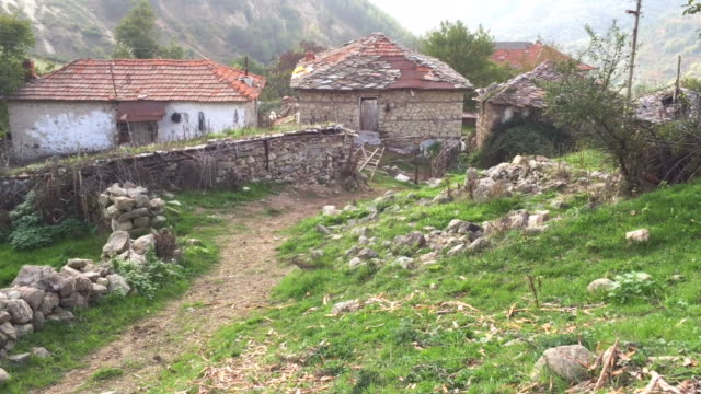 Narrow, old street and old houses in the remote village of Bezvodno in the Rhodope Mountains in Bulgaria