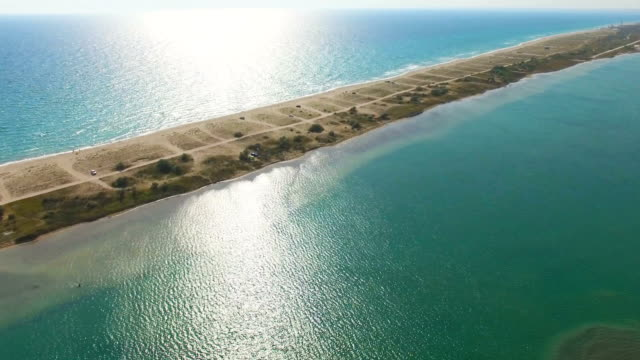 AERIAL: Narrow part of shallow land in blue sea