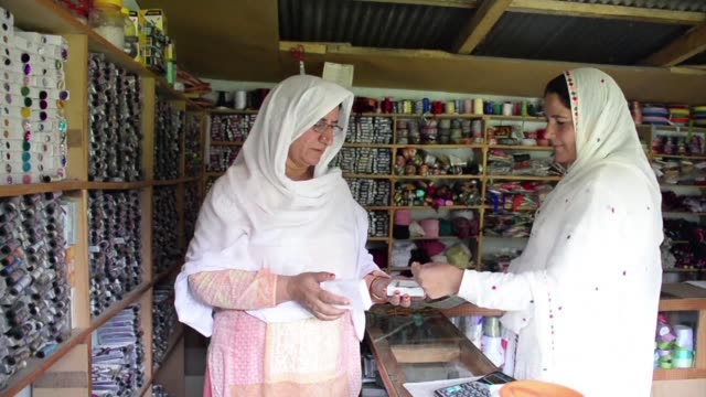 a narrow path winds through kashmir's valley of pearls towards 13 tin roofed shops hidden in a rickety row a women only market that doubles as a... - patriarchy stock videos & royalty-free footage
