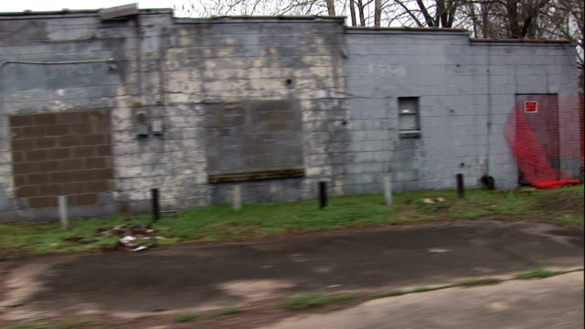 a narrow road passes abandoned buildings in little rock, arkansas. - southern usa stock videos & royalty-free footage