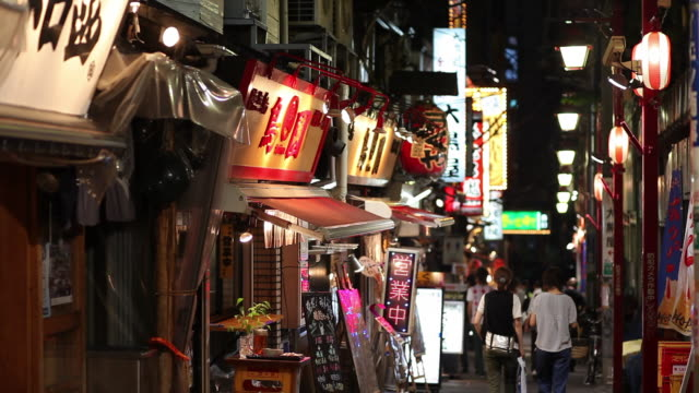 ws narrow shopping street at night / tokyo, japan - nightlife stock videos and b-roll footage