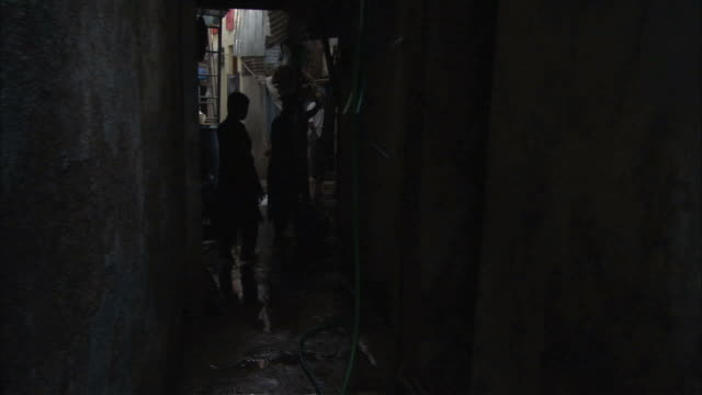 ms pov  narrow slum alley busy with people / mumbai, maharashtra, india - alley stock videos & royalty-free footage