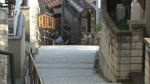 narrow stone steps provide passage between houses on a onomichi hillside. - hiroshima prefecture stock videos and b-roll footage