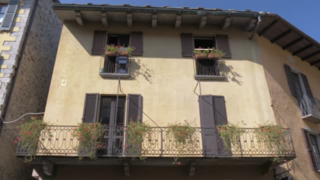narrow street and cafe in cannobio on lake maggiore, lake maggiore, piedmont, italian lakes, italy, europe - italy stock videos & royalty-free footage