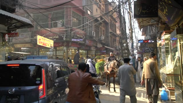 a narrow street at the ander sher bazaar, where gold and jewellery are sold, peshawar, pakistan - pakistan stock videos & royalty-free footage