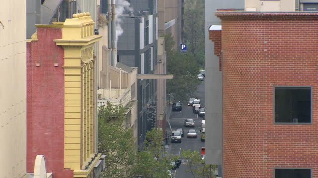 ms narrow street between buildings and traffic moving on street / melbourne, victoria, australia - narrow stock videos & royalty-free footage