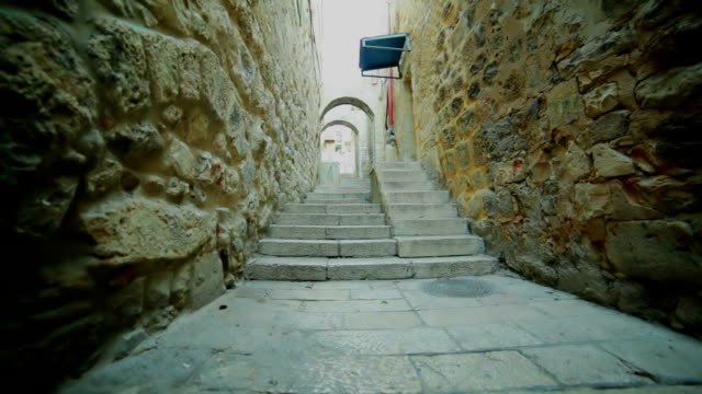 narrow street in old city. staircase and arches. - narrow stock videos and b-roll footage