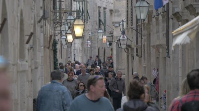 narrow street in old town, dubrovnik old town, unesco world heritage site, dubrovnik, dubrovnik riviera, croatia, europe - narrow stock videos & royalty-free footage