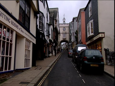 narrow street with shops leading up to old gate house totnes devon - narrow stock videos & royalty-free footage