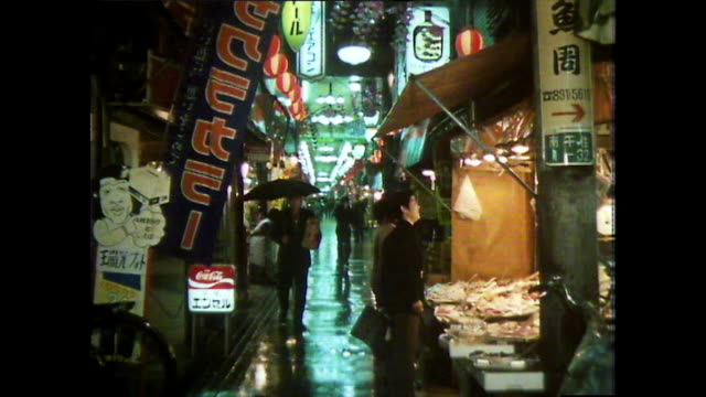 ws narrow street with street food stall at night in tokyo; 1981 - narrow stock videos & royalty-free footage