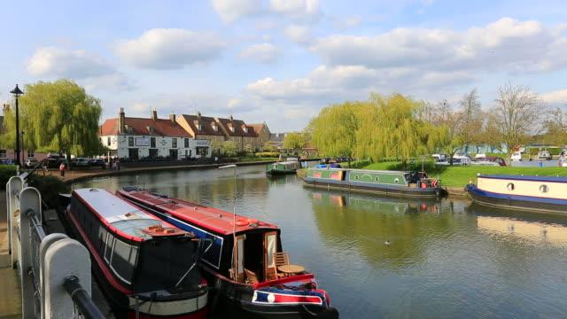 Narrowboats on the river Ouse, Ely city, Cambridgeshire, England, UK