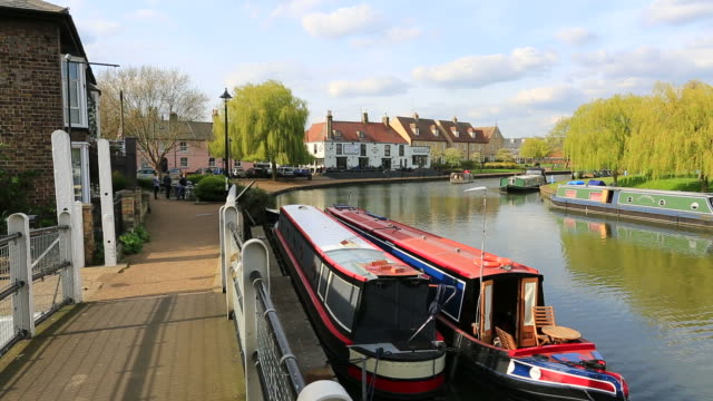 narrowboats on the river ouse, ely city, cambridgeshire, england, uk - promenade stock videos & royalty-free footage