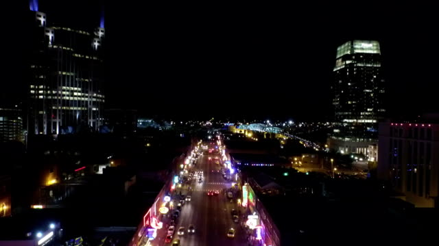 aerial: nashville, broadway at night - nashville stock videos and b-roll footage