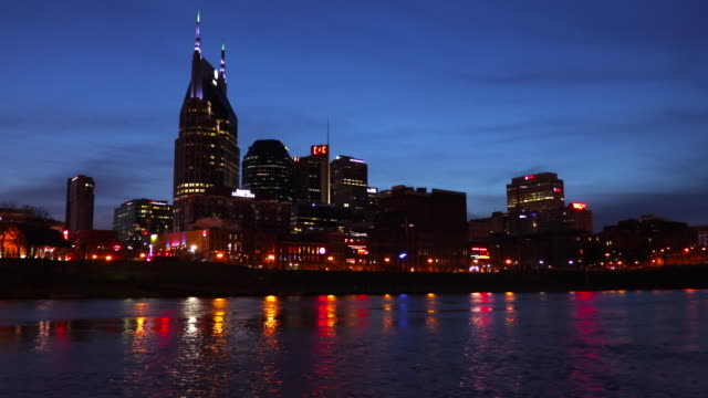 nashville skyline along the banks of the cumberland river - nashville stock videos and b-roll footage